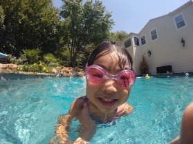 Madee- Age 4 Showing off a big smile after swimming across the pool!