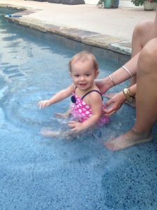 Bailey- Age 9 months Splashing in the pool and getting used to the water.
